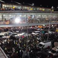 Outraged protesters throng Kennedy Airport in Queens on Saturday after airport security began implementing President Trump's executive order banning travelers from seven predominantly-Muslim countries from entering the United States.