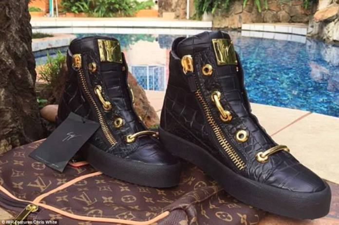 Robert Mugabe Jr shows off his Giuseppe Zanotti alligator skin trainers. The gold-plated footwear sets buyers back a massive $14,000