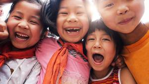 Happy asian children close up