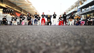 F1 drivers stand up and take a knee