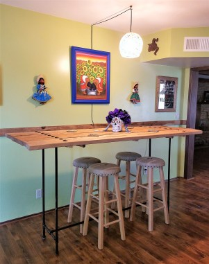 bar height table behind the counter left
