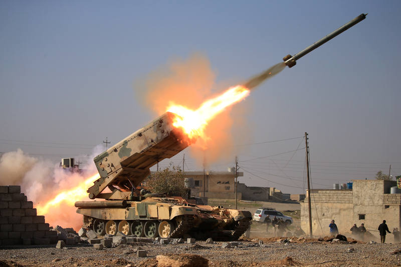 Iraqi army launch a rocket towards Islamic State militants during a battle with Islamic State militants near Ghozlani military complex, south of Mosul, Iraq February 23, 2017. REUTERS/Alaa Al-Marjani TPX IMAGES OF THE DAY