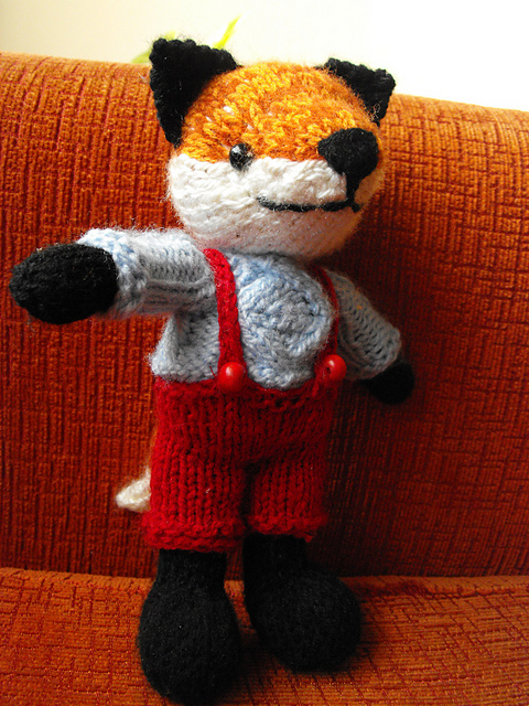 Knitted amigurumi foxes