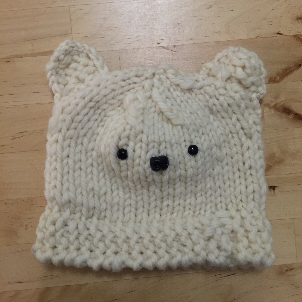 Baby hat to knit with bear ears.