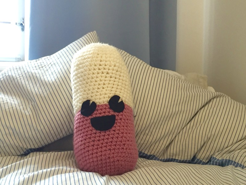 The finished Happy Pill-ow. Make your own with a free crochet pattern.