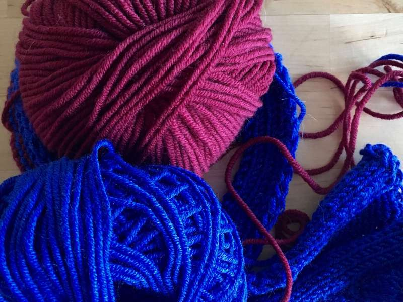 Maroon and blue yarn together