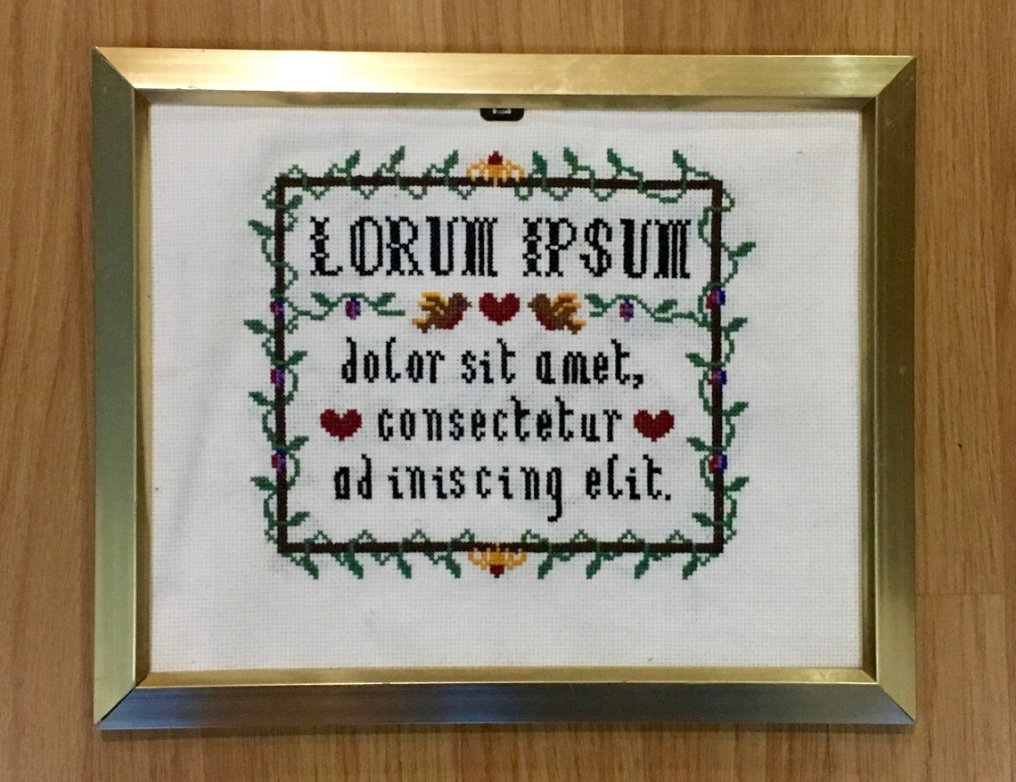 Lorum ipsum cross stitch sampler