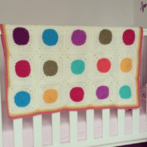 Bouncy ball crocheted granny square blanket with ciruclar motif