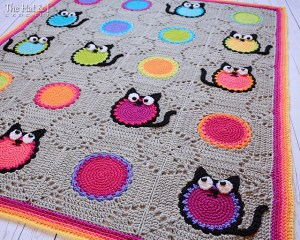 Crocheted blanket with cat motifs
