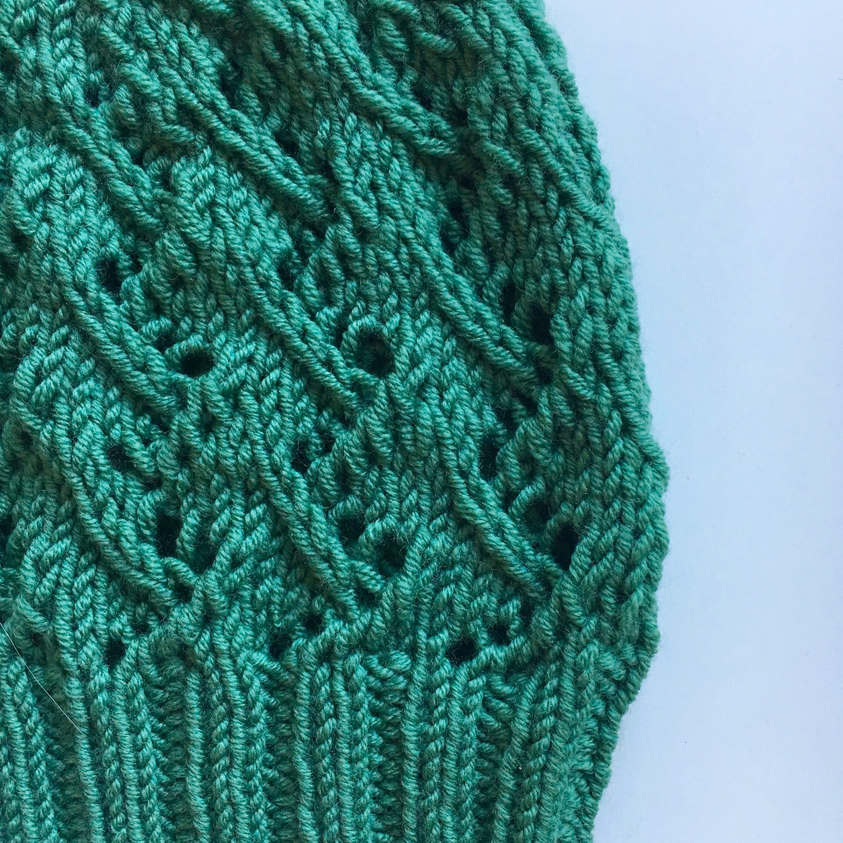 Close up of beanie with leaf like lace