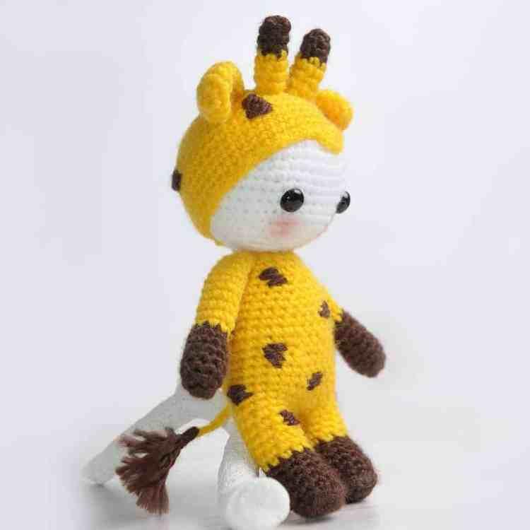 Amigurumi doll dressed in giraffe costume - free crochet pattern