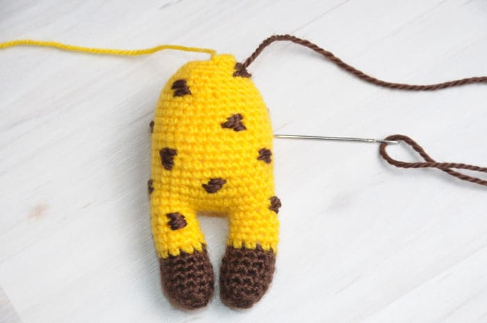 Amigurumi doll in giraffe costume - embroidering spots