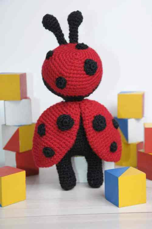 Amigurumi doll in ladybug costume - crochet pattern