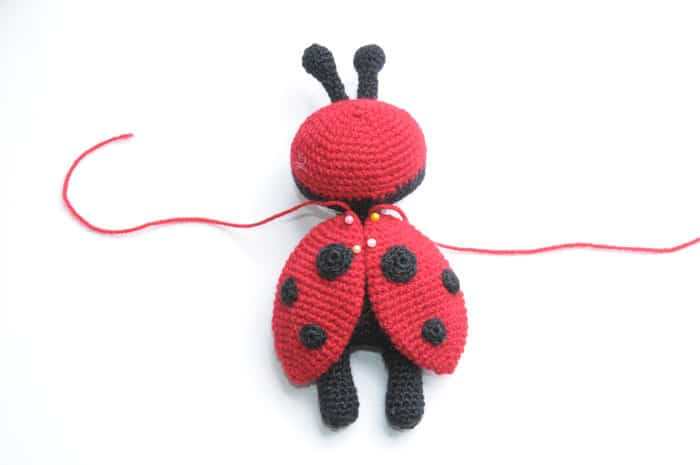 Amigurumi doll in ladybug costume - wings
