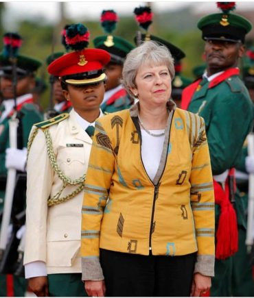 British Prime Minister Theresa May Looks Stunning Wearing Nigerian Designer Emmyskabit