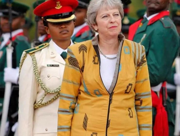 British Prime Minister Theresa May Looks Stunning Wearing Nigerian Designer Emmyskabit