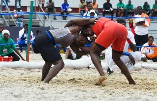 Abidjan (AFP)© 2017 AFPFrancophonie-sport-culture-AFR-2017-CIV-lutte-tradition-ROU-SEN