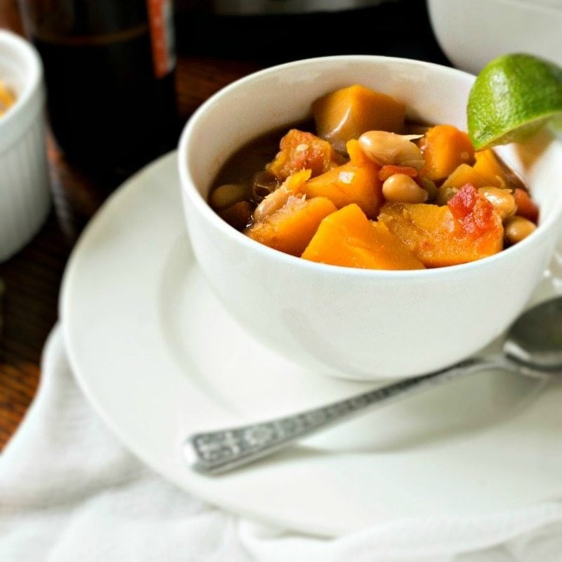 A hearty, slow-cooker, vegetarain dish featuring butternut squash, white beans, beer and chipotle peppers. It is spicy, tangy, creamy, filling and warming to the soul! Vegan. Gluten-Free.