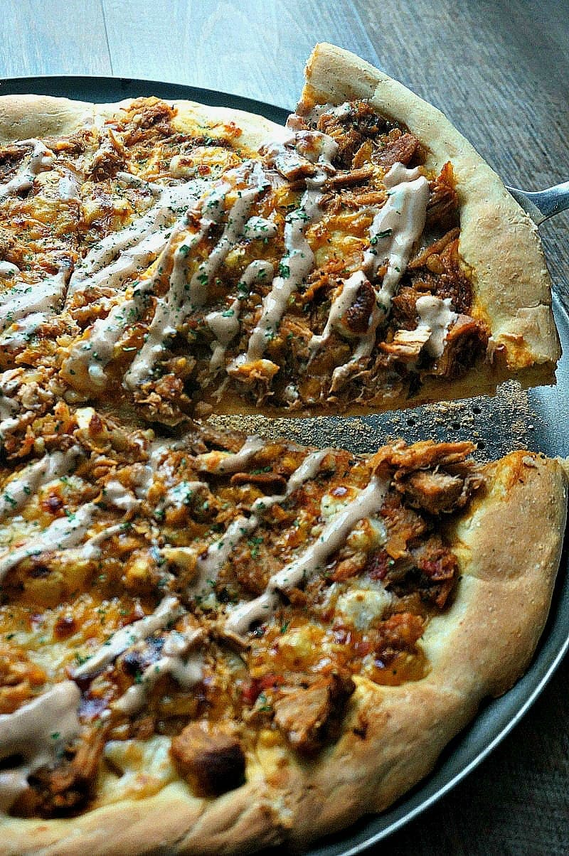 Pineapple Chipotle Chicken Pizza: Tender chicken, sweet pineapple, and tangy sauce are topped with sharp cheddar cheese and a chipotle cream drizzle forming one pizza that is a little bit Tex-Mex and a whole lot of flavor!