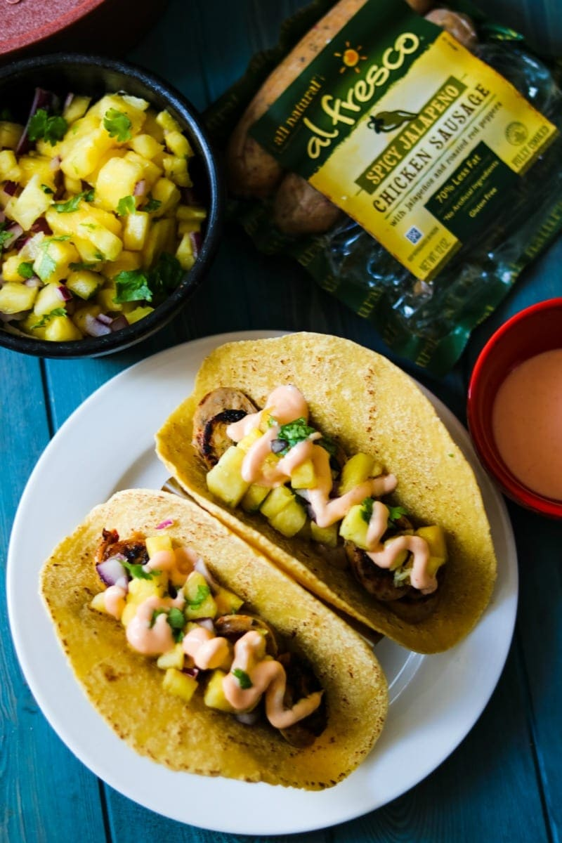 Sweet and Spicy Chicken Taco made with @alfresco Chicken Sausage and a fresh pineapple salsa. Completed with a chipotle creama.