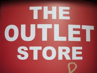 The outlet store sign in shopping mall