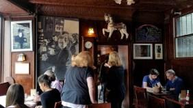 Visitors examine the décor and Thomas memorabilia