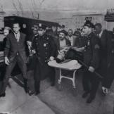 Malcolm X being removed from the Ballroom on a stretcher after the shooting in 1965