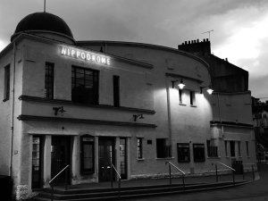 External view of art deco cinema in black and white.