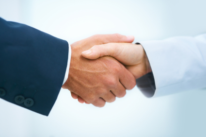 Cropped view of two business executives shaking hands