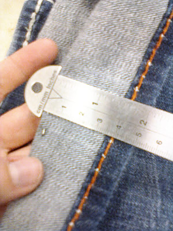 how to hem jeans tuck method measuring amount to remove
