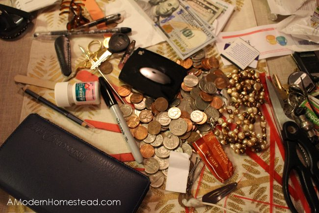 messy purse contents dumped on table