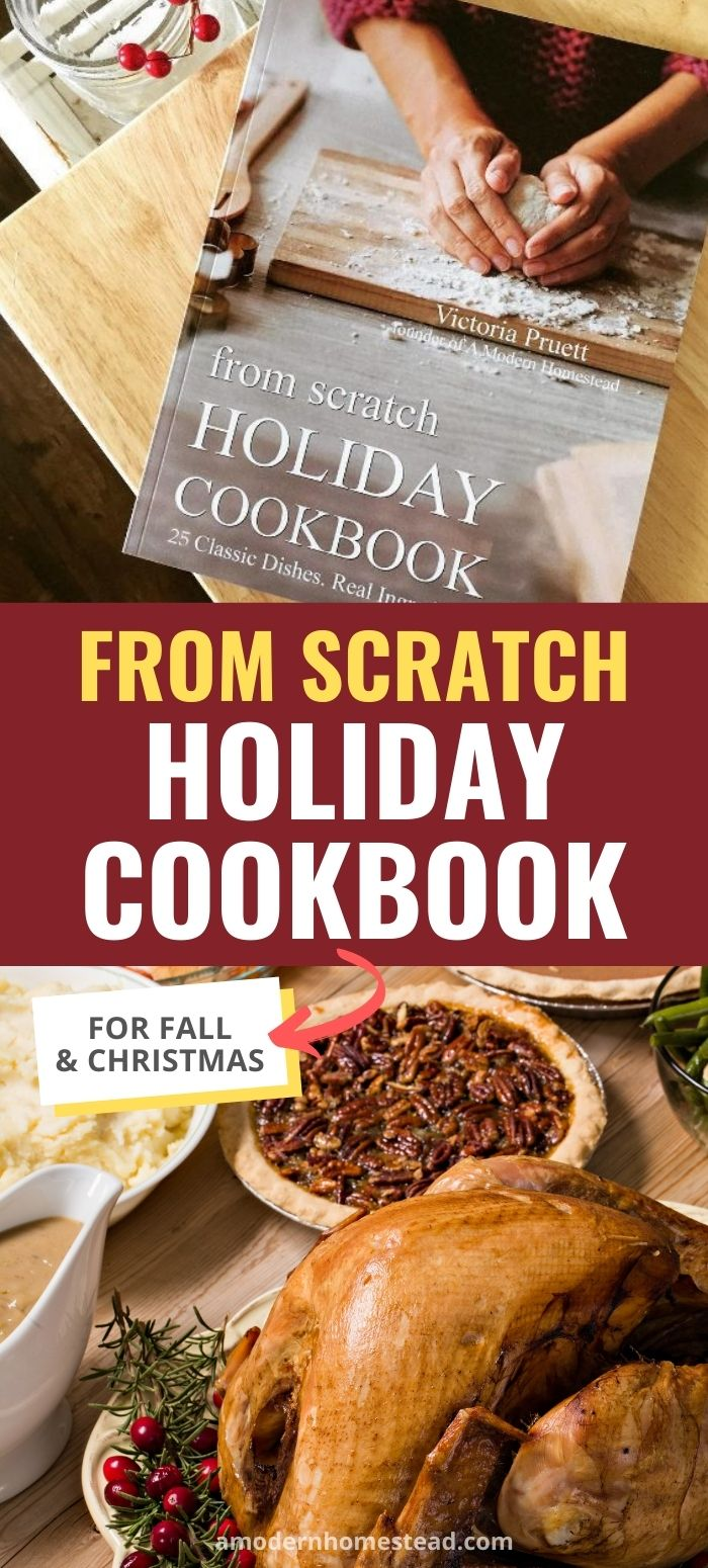 From scratch holiday cookbook on wood surface with holiday meal in background