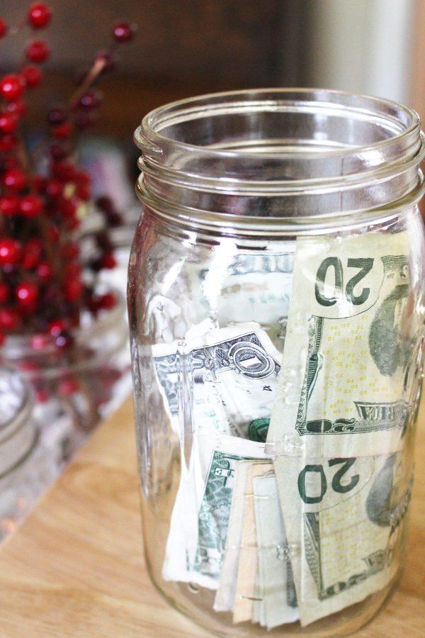 money bills in a mason jar