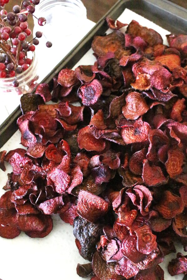 Finished beet chips cooling on a baking sheet