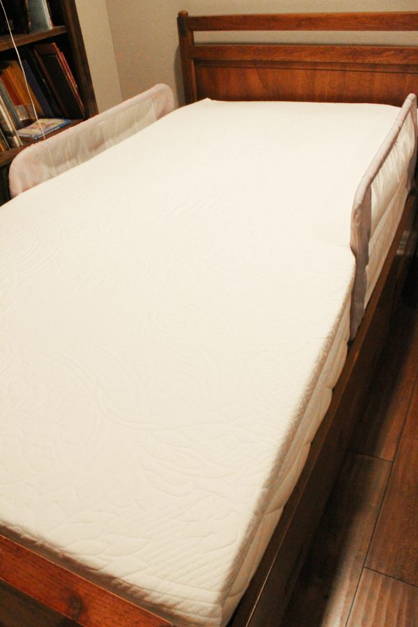 organic mattress in wooden bed frame, no sheets