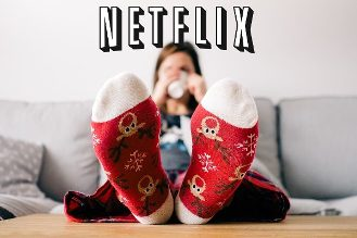 Woman watching hallmark christmas movies on netflix