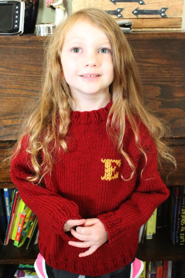 Little girl wearing handknitted weasley sweater