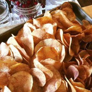 homemade potato chips on baking sheet