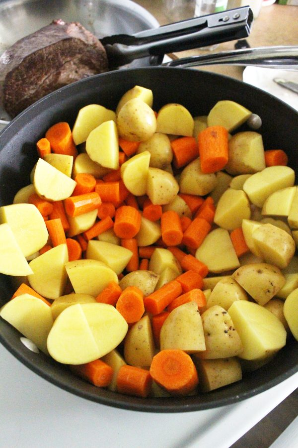 carrots and potatoes in roasting pan
