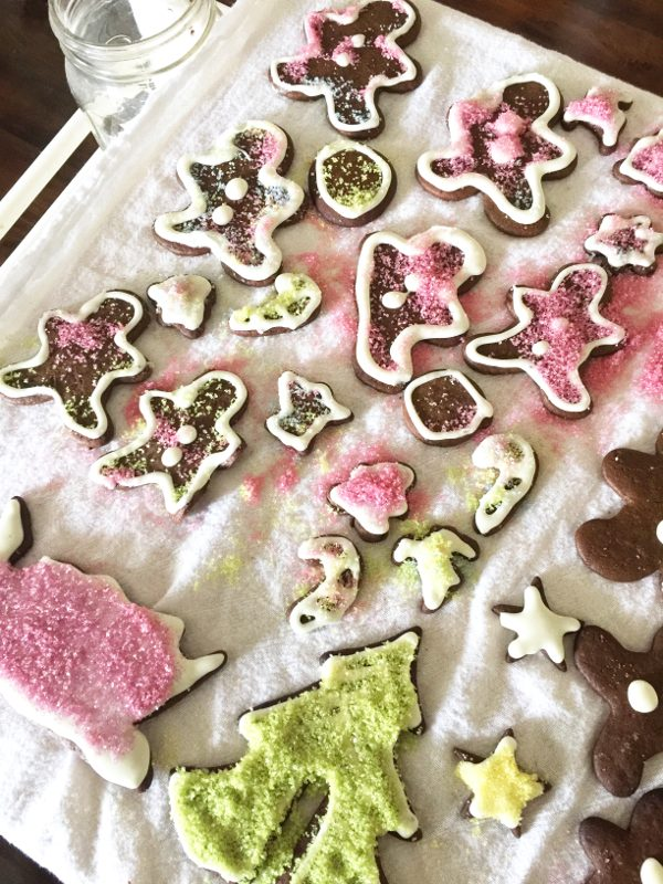 Using homemade colored sugar on gingerbread cookies