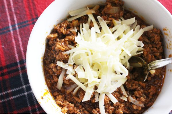 Easy homemade chili recipe topped with cheese
