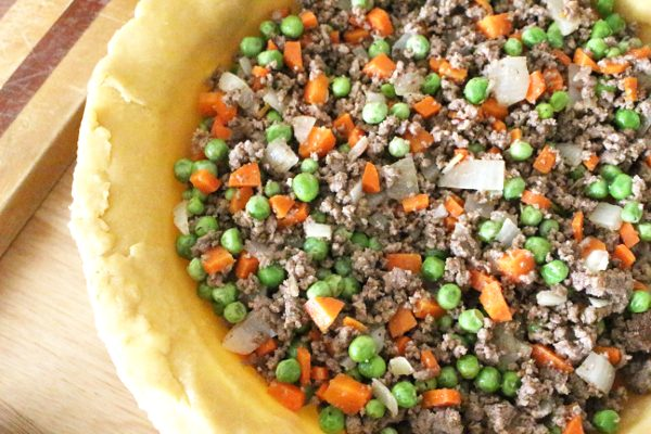 Shepherd's pie filled with meat and vegetables in a pie crust