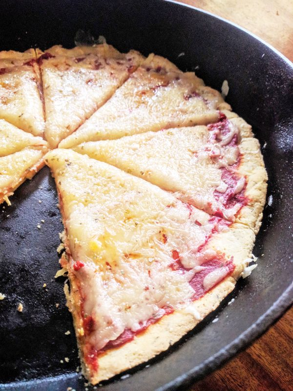almond flour pizza crust finished in cast iron skillet