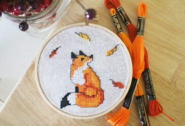 close up of fox cross stitch pattern in fall colors