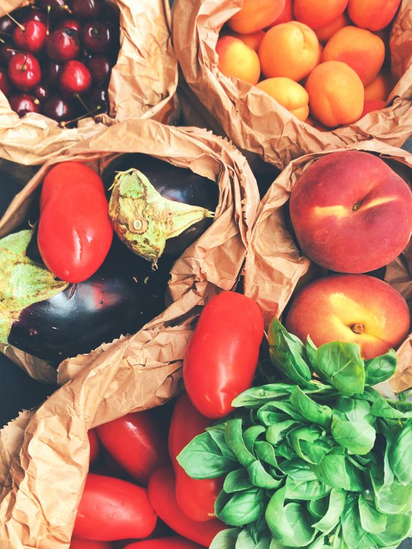 Fresh produce in brown bags