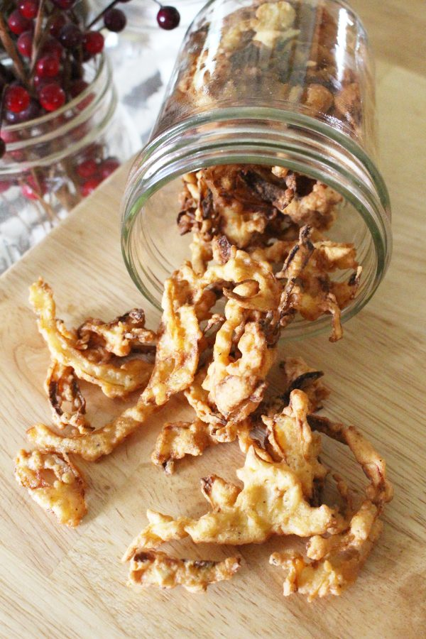 Homemade fried onions on wooden counter in mason jar