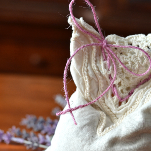 adding ribbon to decorate your lavender sachets