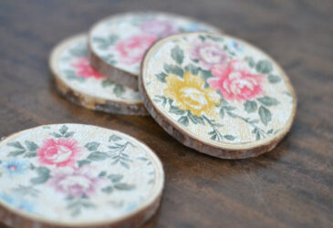 floral wood coasters on a wood table