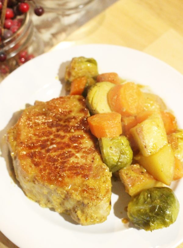 honey mustard pork chops and vegetable dinner recipe on plate