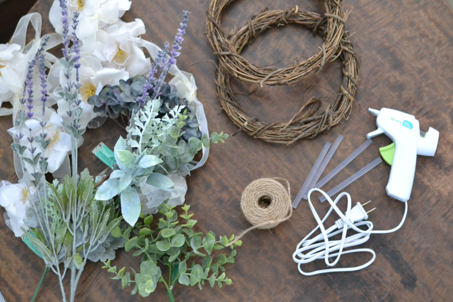 supplies needed to make a spring mini-wreath sitting on a table